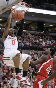Ohio State forward Jared Sullinger, left, dunks the ball over Miami (Ohio) forward Nick Winbush during the first half of an NCAA college basketball game in Columbus, Ohio, Friday, Nov. 26, 2010. (AP Photo/Paul Vernon) NYTCREDIT: Paul Vernon/Associated Press